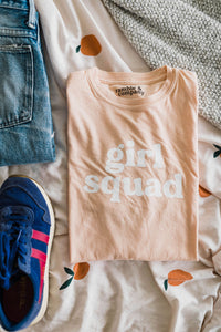 Ramble and Company's girl squad unisex soft comfortable inspirational graphic t-shirt in apricot flat lay