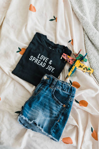 Ramble and Company's love and spread joy kids soft comfortable inspirational graphic t-shirt in pirate black flat lay