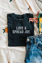 Load image into Gallery viewer, Ramble and Company's love and spread joy kids soft comfortable inspirational graphic t-shirt in pirate black flat lay