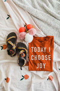 Ramble and Company's today i choose joy kids soft comfortable inspirational graphic t-shirt in hawaiian sunset flat lay