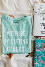 Load image into Gallery viewer, Ramble and Company's we rise by lifting others kids soft comfortable inspirational graphic t-shirt in grayed jade flat lay