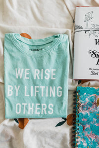 Ramble and Company's we rise by lifting others kids soft comfortable inspirational graphic t-shirt in grayed jade flat lay