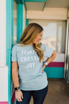 woman wearing Ramble and Company's today i choose joy unisex soft comfortable inspirational graphic t-shirt in harbor grey front view close up