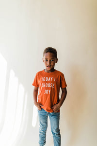 kid wearing Ramble and Company's today i choose joy kids soft comfortable inspirational graphic t-shirt in hawaiian sunset front view
