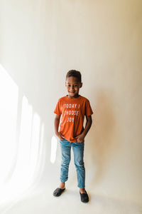 kid wearing Ramble and Company's today i choose joy kids soft comfortable inspirational graphic t-shirt in hawaiian sunset front view full body