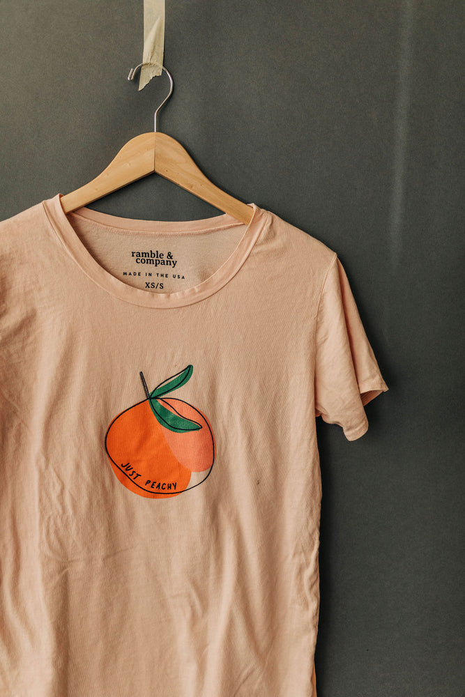 the just peachy everyday tee by Ramble & Company || USA Made || shop now at rambleandcompany.com or visit our storefront in downtown Wichita Falls, Texas || soft inspirational graphic t-shirts || wholesale available