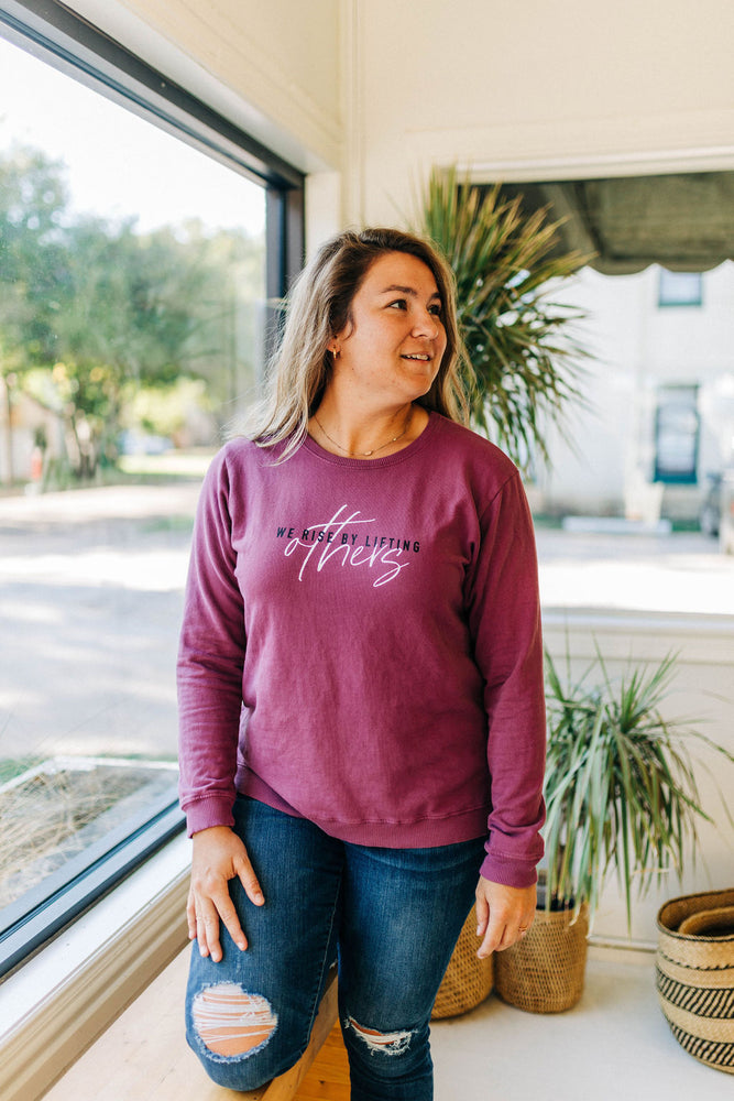 the we rise side slit sweatshirt by Ramble & Company || shop now at rambleandcompany.com or visit our storefront in downtown Wichita Falls, Texas || soft inspirational graphic sweatshirts and t-shirts