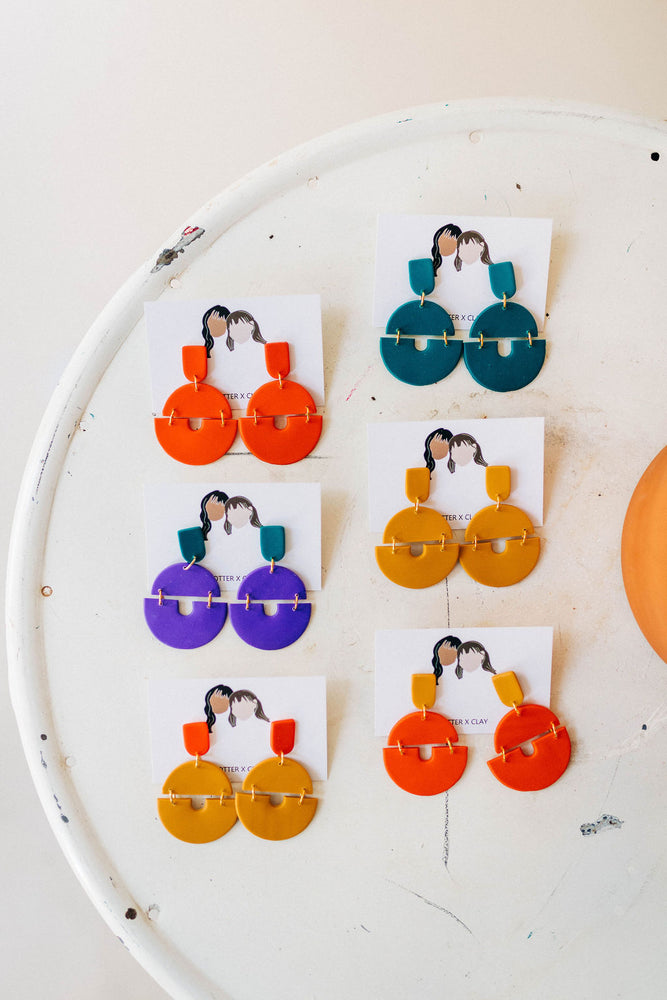 the sunset earrings by Potter x Clay + Ramble & Company || shop now at rambleandcompany.com or visit our storefront in downtown Wichita Falls, Texas || soft inspirational graphic t-shirts