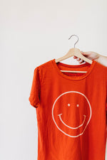 the smile tee | gold flame