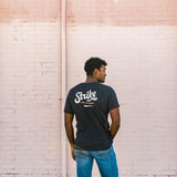 the strike from the heart tee | charcoal