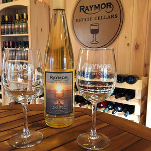 White wine glasses on display at Raymor Cellars Tasting Room. Photo accompanies description of a Private Tasting event. Tasting incldudes a total of six wines or ciders and more. Contact Raymor Cellars for details.