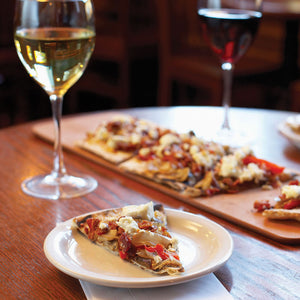 Image of craft wood-fired pizza with glasses of wine.  Event is for private tasting with wood-fired pizza. Best for groups of four to twelve guests. Please contact Raymor Cellars for details.