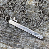 Sterling silver stick pendant with flower