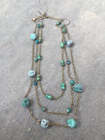 Three strand gemstone and chain necklace