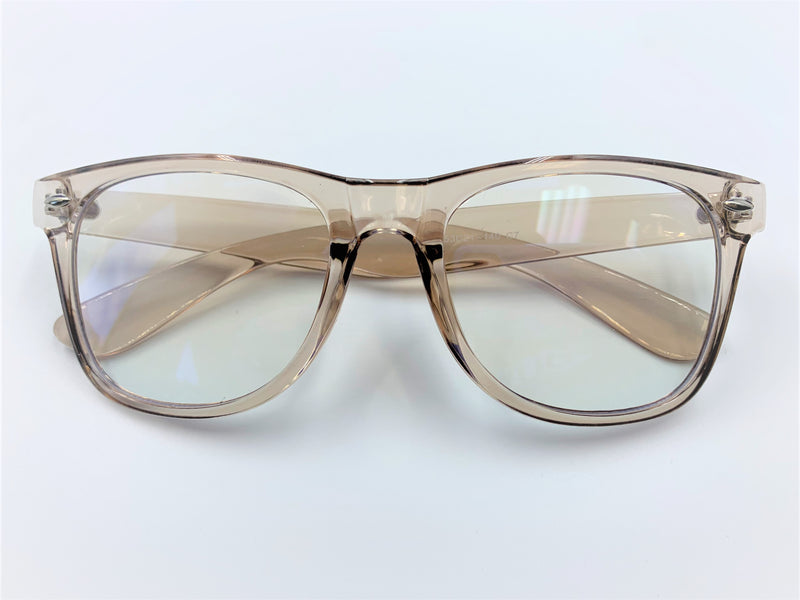 Blue light filtering glasses with translucent champagne colored frame