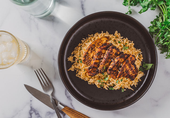 grilled ancho chile chicken breast cutlets over rice