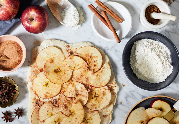 Sliced apples and freshly ground cinnamon going into fresh baked creations.