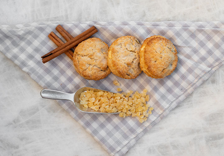 Apple pie spice scones made with crystallized ginger pieces.
