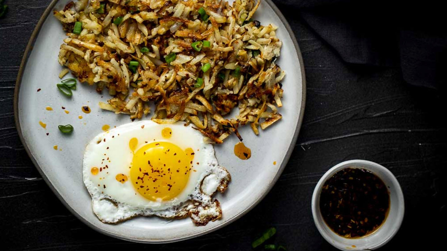 Asian hash browns with over easy egg