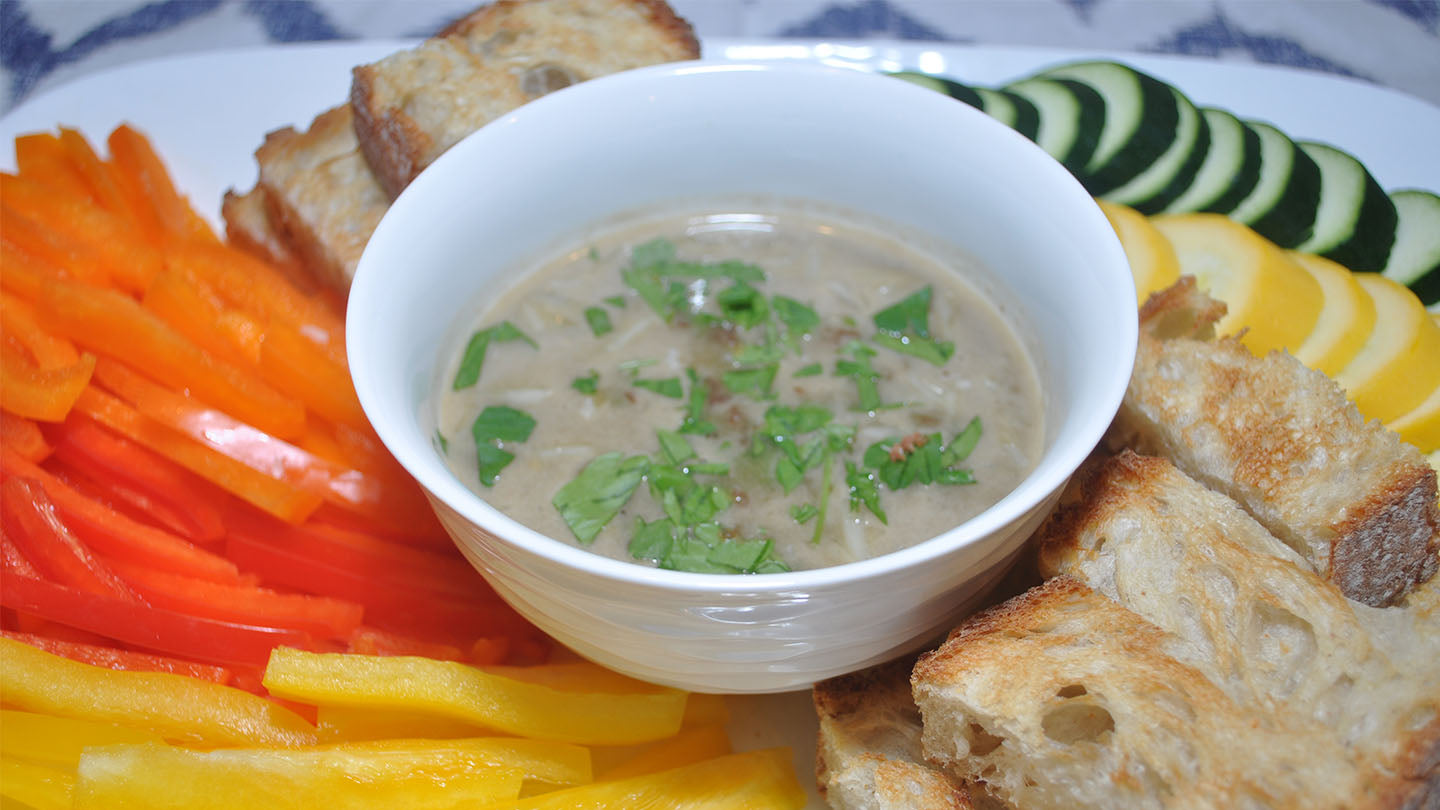 Bagna cauda dip served with cut vegetables and bread slices