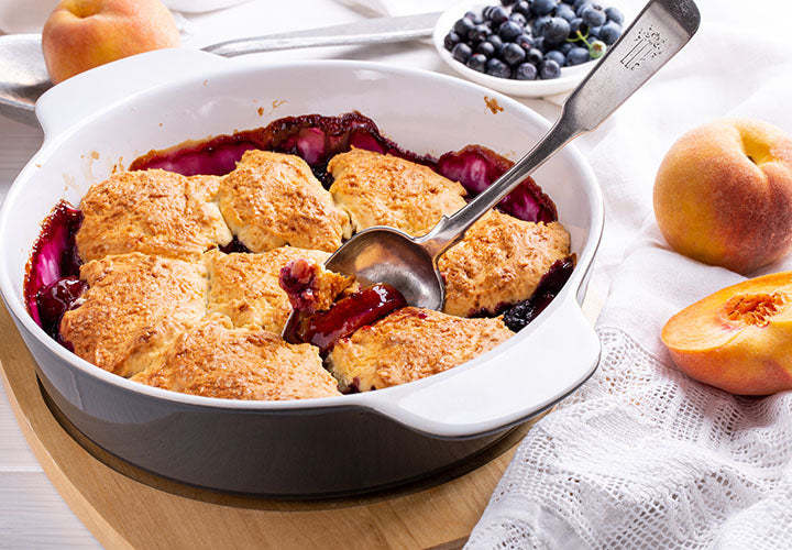 Rustic cobbler with peaches and blueberries.