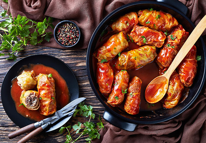 Yummy cabbage rolls in a paprika-spiced red sauce in a pan