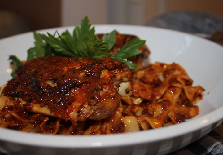 Chicken paprikash made with Hungarian sweet paprika over egg noodles