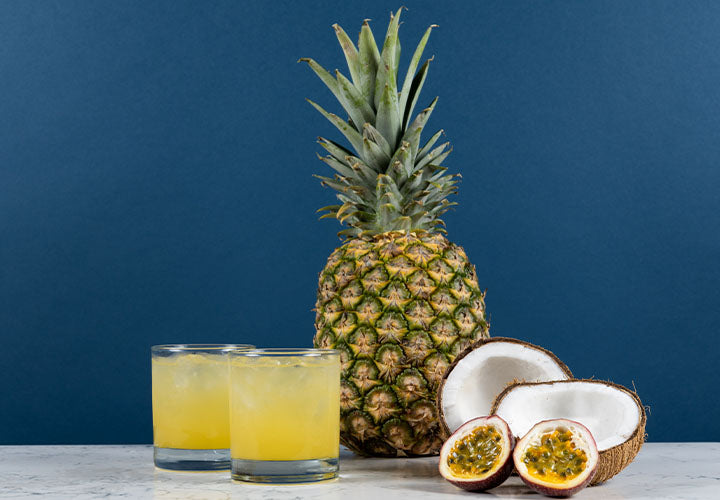 Delicious fruit punch recipe with pineapple, passion fruit, and coconut extract.