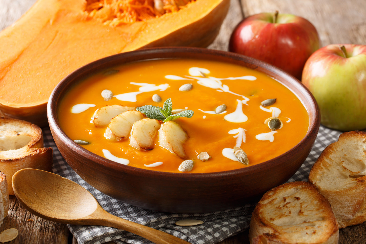 Cozy fall soup made with pumpkins, apples, and seasoned with ginger spice.