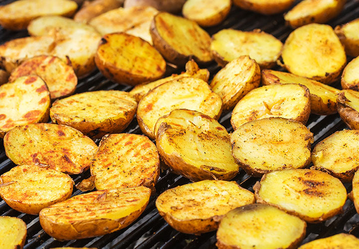 Grilling small gold potatoes for a potato salad with shallots and scallion.