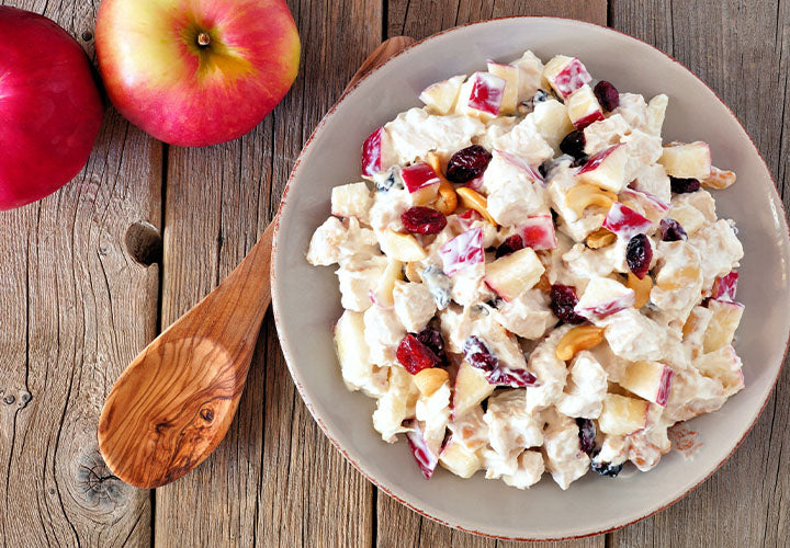 Potato salad with apples, nuts, and dried cranberries.
