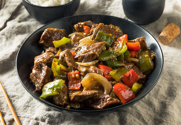Sichuan style beef stir fry with peppers and seasoned with ginger spice.