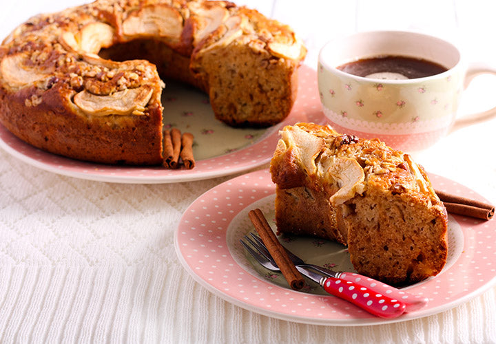 Apple cake made with sweet baking spices baked in a round bundt pan.
