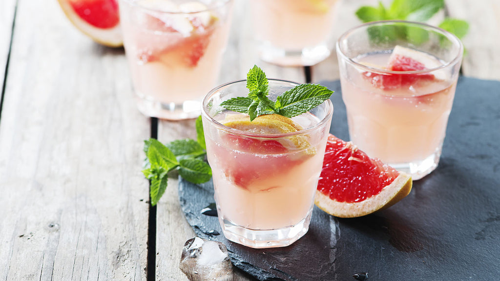 Refreshing summer drink recipe with grapefruit and mint leaves.