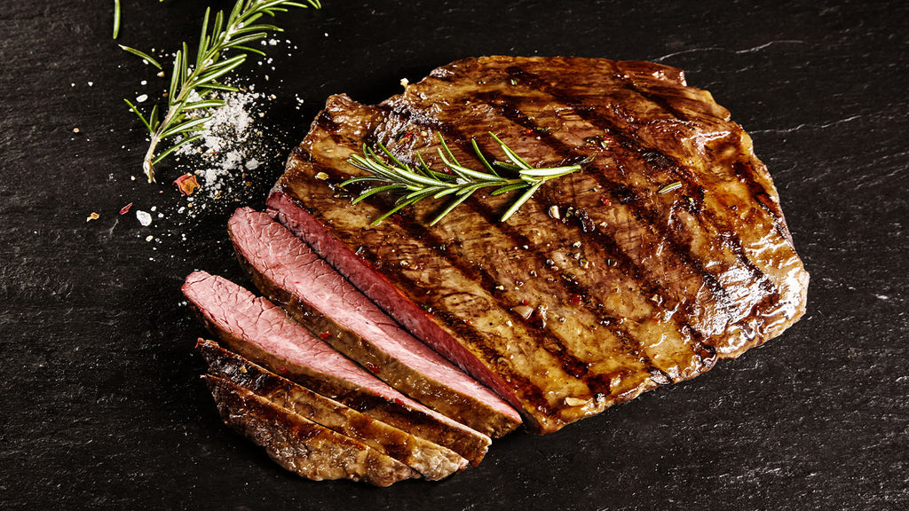Grilled Beef Flank Steak marinated in spices and worcestershire sauce.