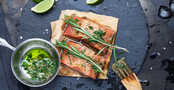 Marinade for grilled salmon with lime and rosemary herbs.