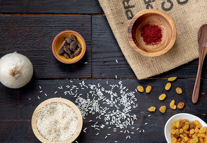 Saffron spice sitting on a table with rice and other spices