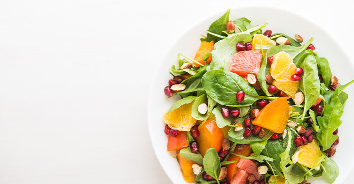 Delicious salad with persimmon citrus and almonds.
