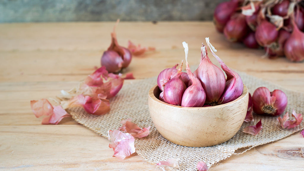 Shallots in a bowl, ready for cooking