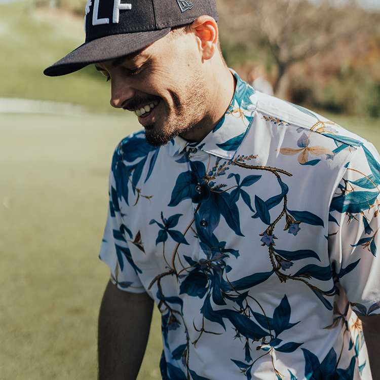 Devereux's Magnum Polo is a Hawaiian inspired Golf Polo with a blue floral print. Perfect for golf, hot weather, or as a gift.
