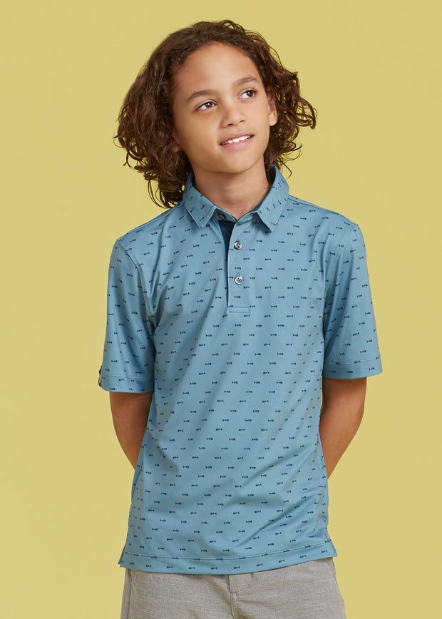 Kids sage blue active polo with all over dark blue fish bone print and three button placket