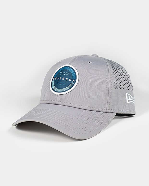 Light grey baseball cap with blue and white Devereux Proper Threads embroidered circle patch and mesh backing