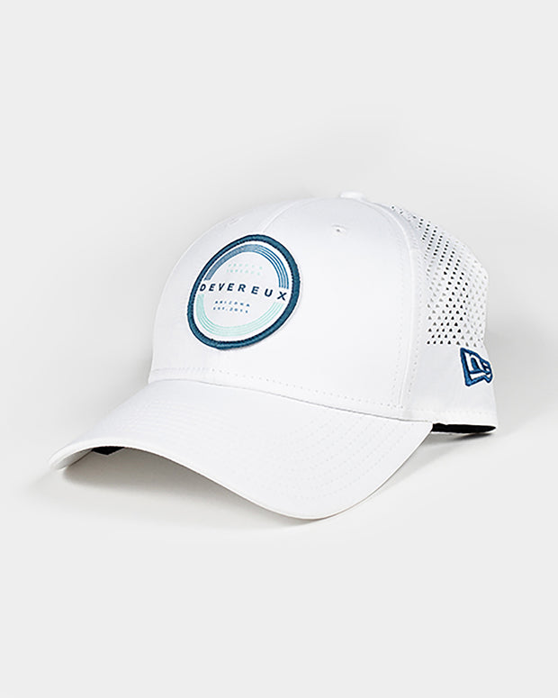 White adjustable baseball cap with blue and white Devereux Proper Threads embroidered circle patch and mesh backing