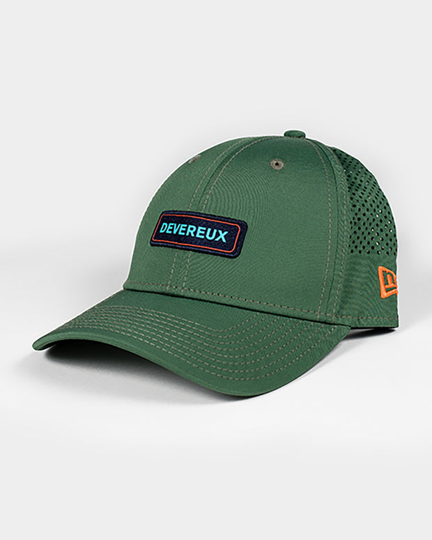 Olive green baseball cap with devereux in light blue font and orange outline rectangle embroidered patch and mesh backing