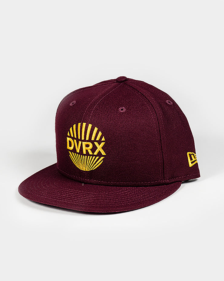 Maroon hat with gold yellow embroidered DVRX rising sun graphic