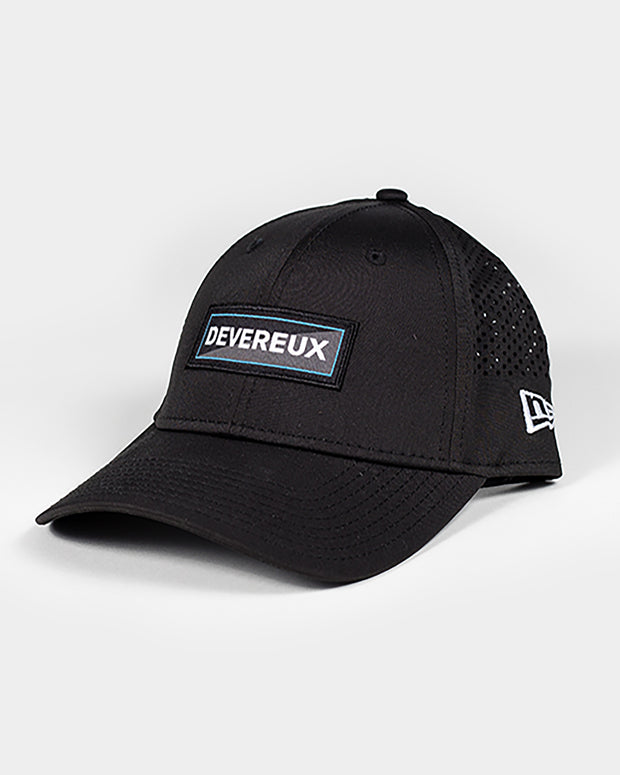 Black baseball hat with devereux blue and black slice embroidered rectangle patch and mesh backing