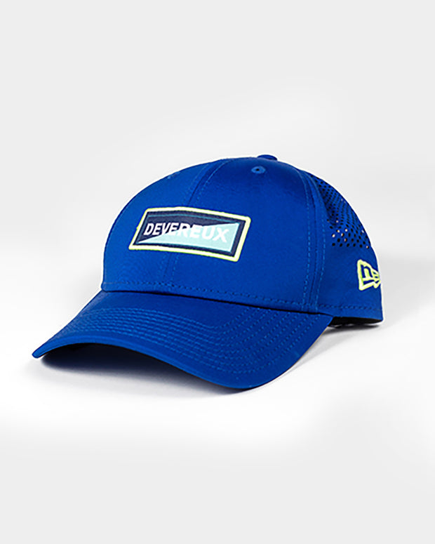 Royal blue baseball cap with devereux dark blue and light blue slice embroidered rectangle patch and mesh backing