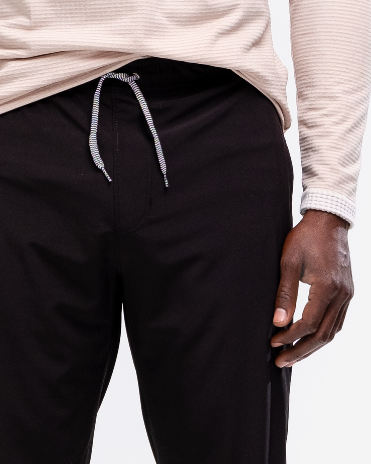 Black lightweight joggers with reflective ankle zipper and drawstring waistband