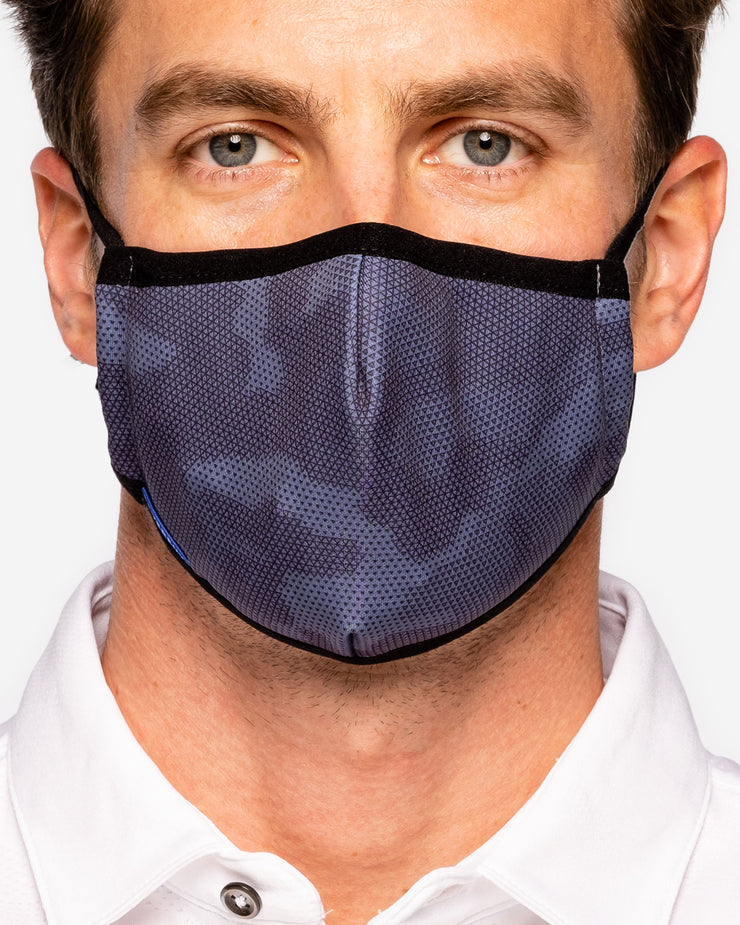 Man wearing Grey-Bue camo cotton face mask with blue DEVEREUX tag