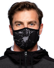 Man wearing Black and grey marble face mask with blue DEVEREUX logo tag